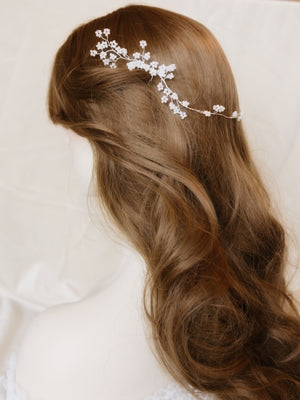 Romantic bridal hairstyle hair comb, pretty flowers delicately hand beaded