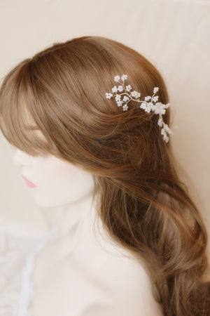 Romantic wedding hair down with white floral bridal accessory