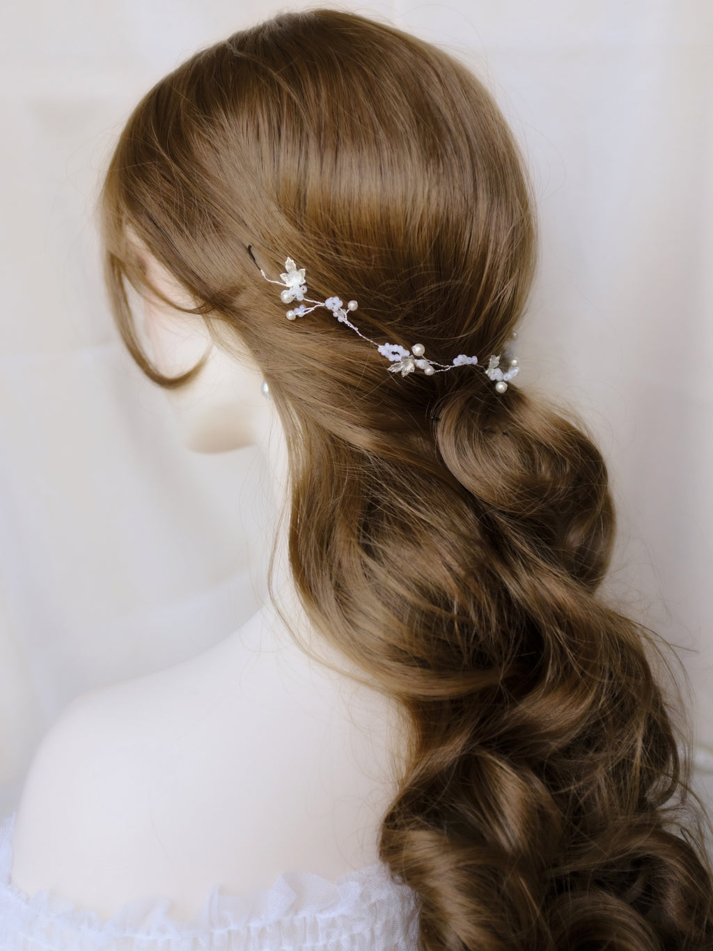Ethereal bridal hair vine with silver leaves and white flowers for hair down wedding hairstyle