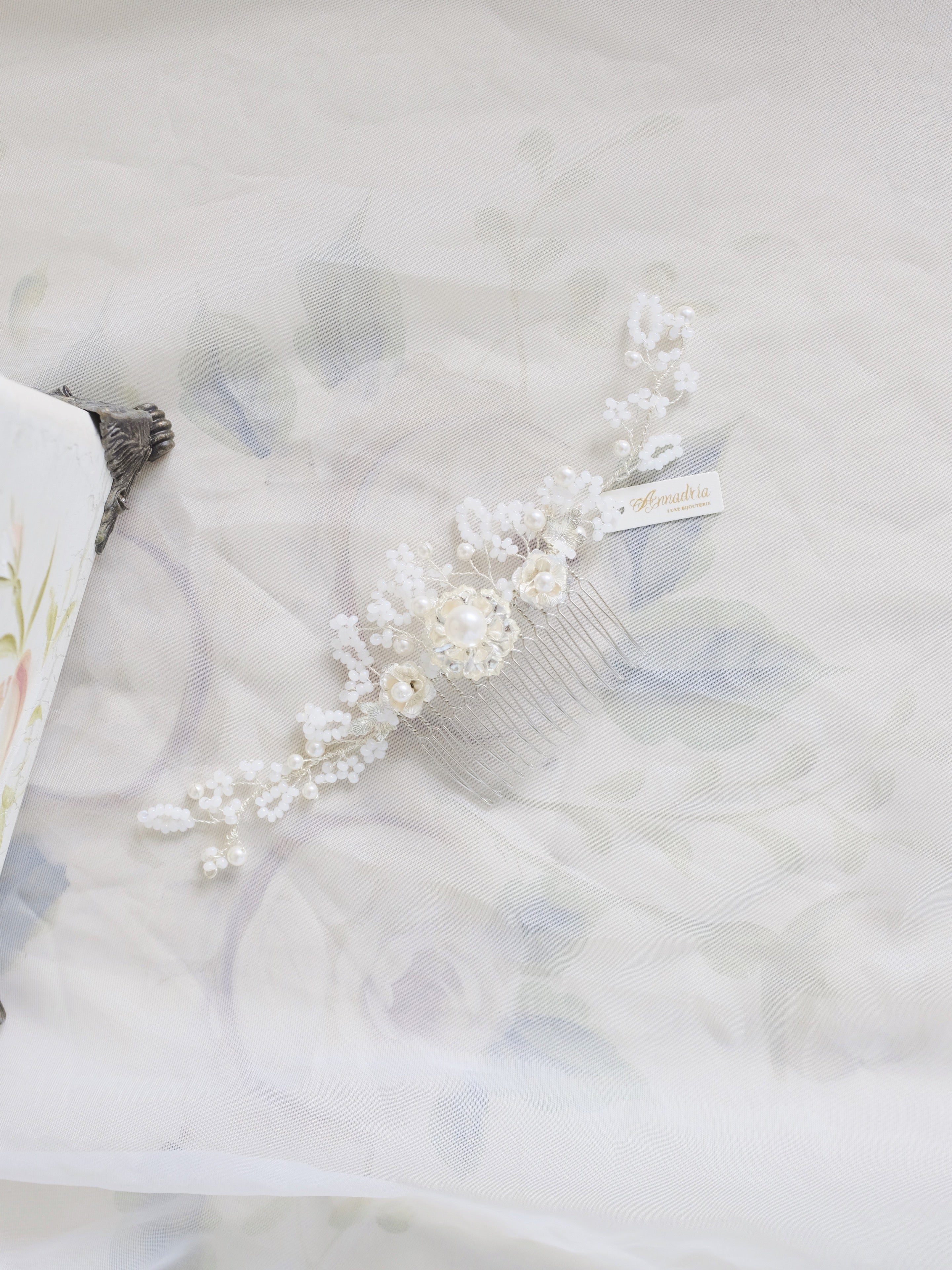Vintage inspired bridal hair comb in white, for elegant and classic luxury weddings