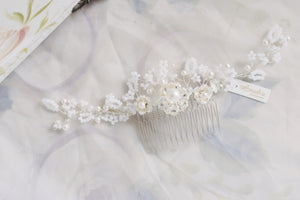 Vintage style hair comb with Swarovski pearls and white beaded flowers. Classic beautiful accessories that make a unique gift for brides.