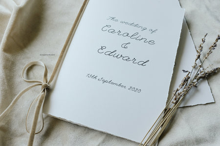 Caroline & Edward ceremony booklets with beige velvet ribbon