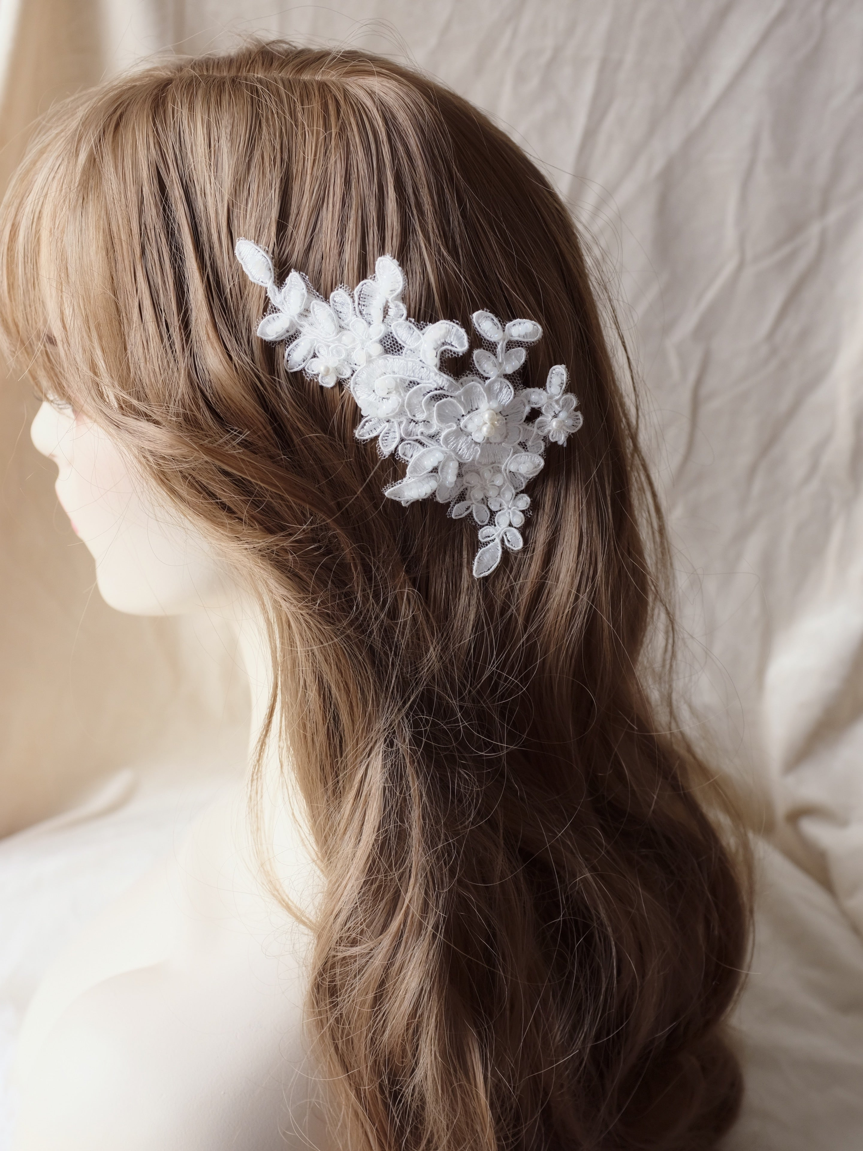 Bridal hair down hairstyle with white lace hair comb