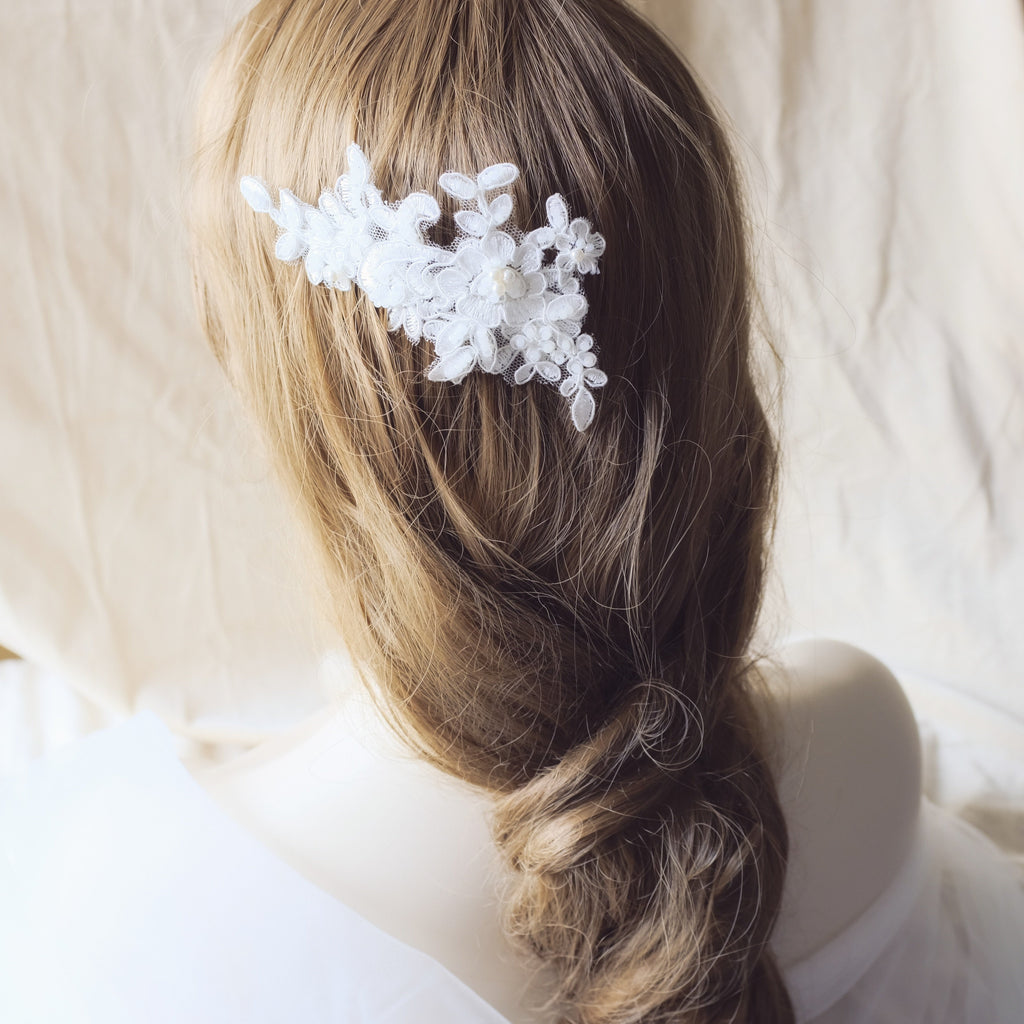 Romantic bridal hair comb with lace and pearls, braided wedding hairstyle