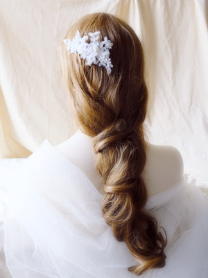 Romantic bridal hairstyle braid with handmade lace hair piece