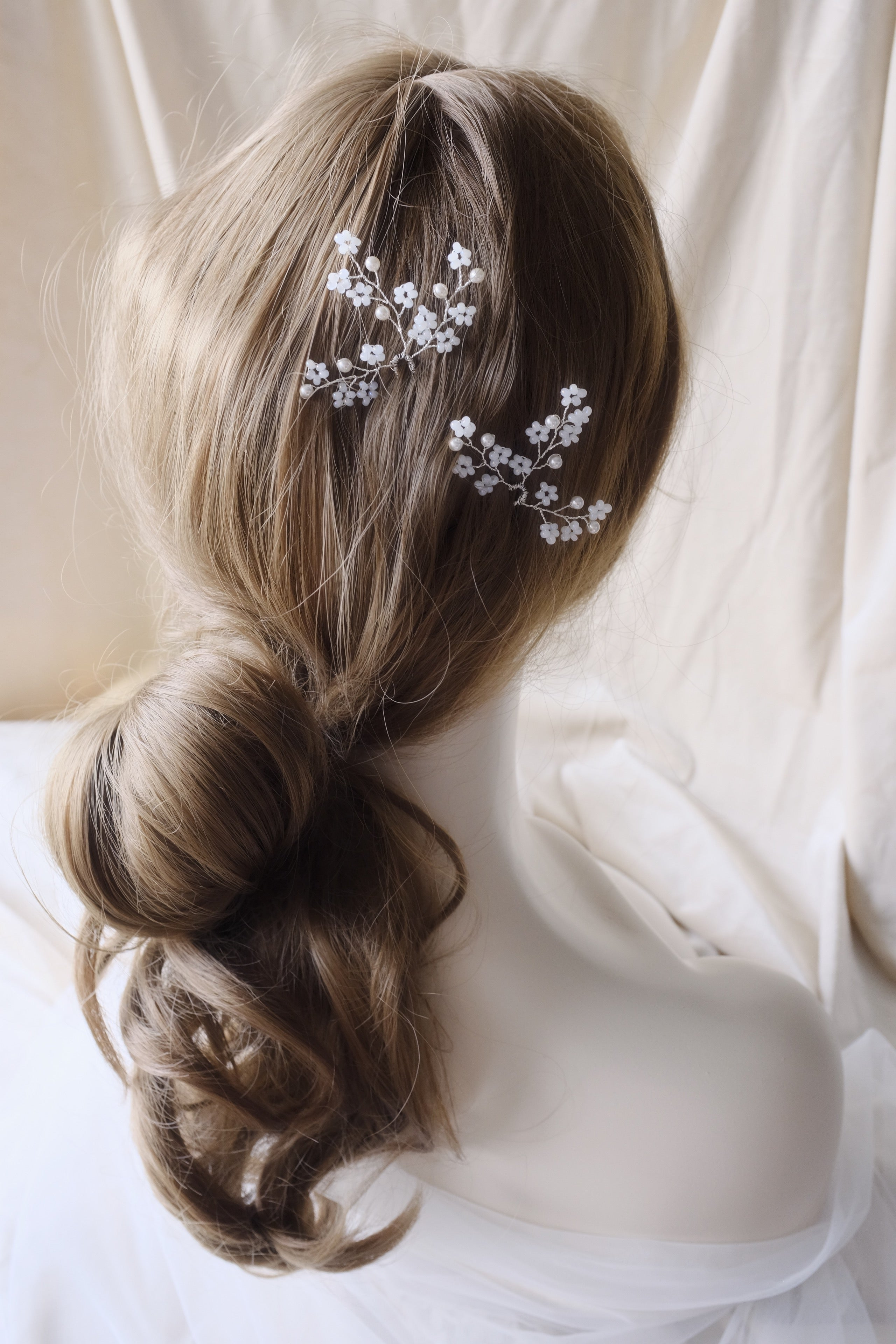 Elegant bridal updo loose curls with hair accessories