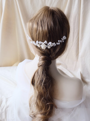 White bridal beaded headpiece, handmade with silver flowers and Swarovski pearls in Hong Kong and Singapore