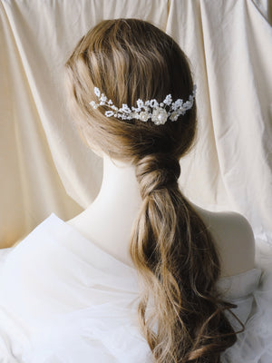 Classic wedding ponytail hairstyle with bridal hair comb accessory