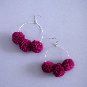 Betty pom pom earrings in Berry