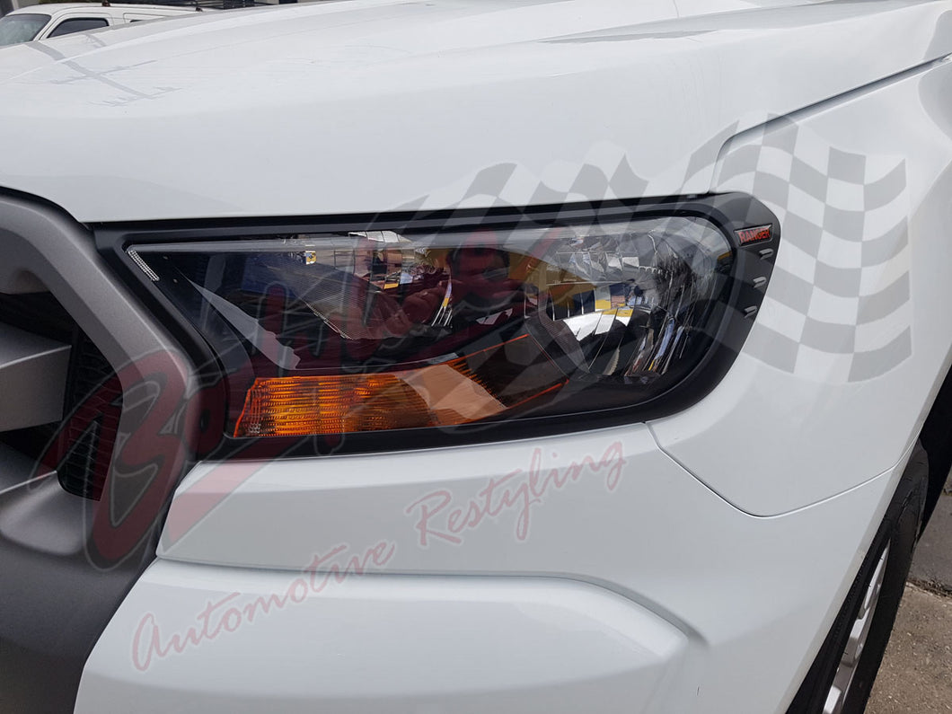 FORD RANGER PX2 2015on HEAD LIGHT TRIM FRAMES MATT BLACK ranger red logo