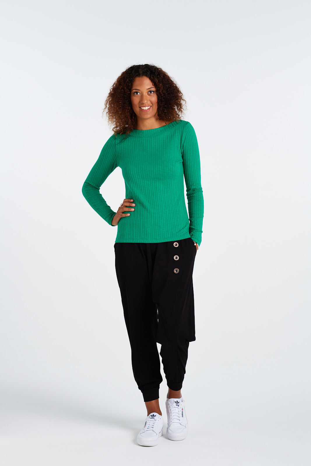 Super comfy wide elasticated band, this knit harem pant gathers into the waist band with a tapered full length leg. Features a front faux placket, cute metallic buttons and handy side pockets. Comes in classic black and can be teamed with our Lucia Jumper, and any of our amazing Bettie Blouses.