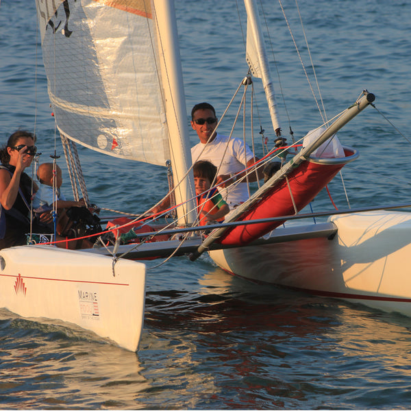 Sea romance in a boat - sailing catamaran or yacht. It's up to you.