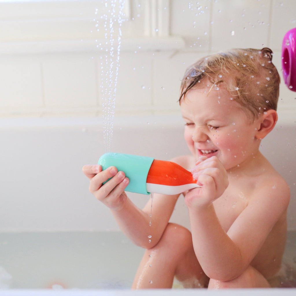 Child playing in bath with Squirting Whale bath toy