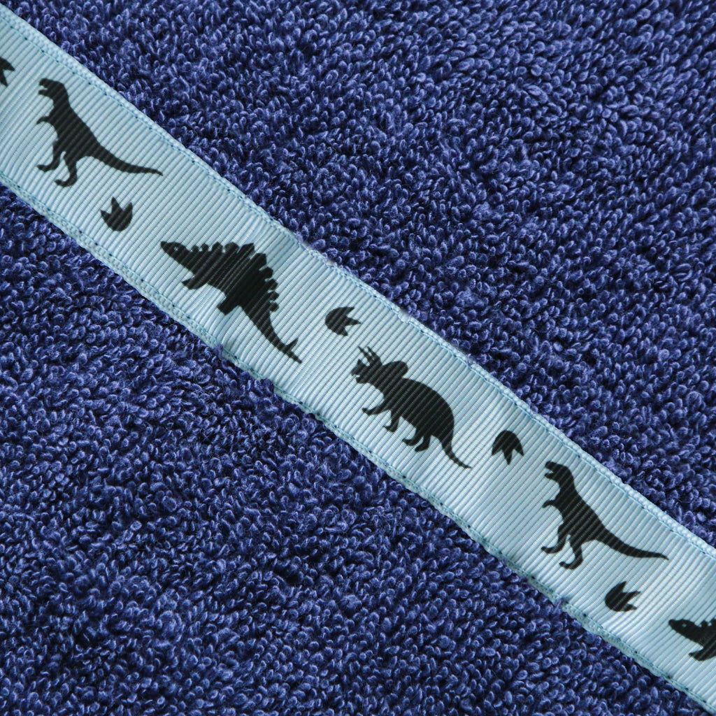 Close of of the Dinosaurs trim of a navy blue hooded towel