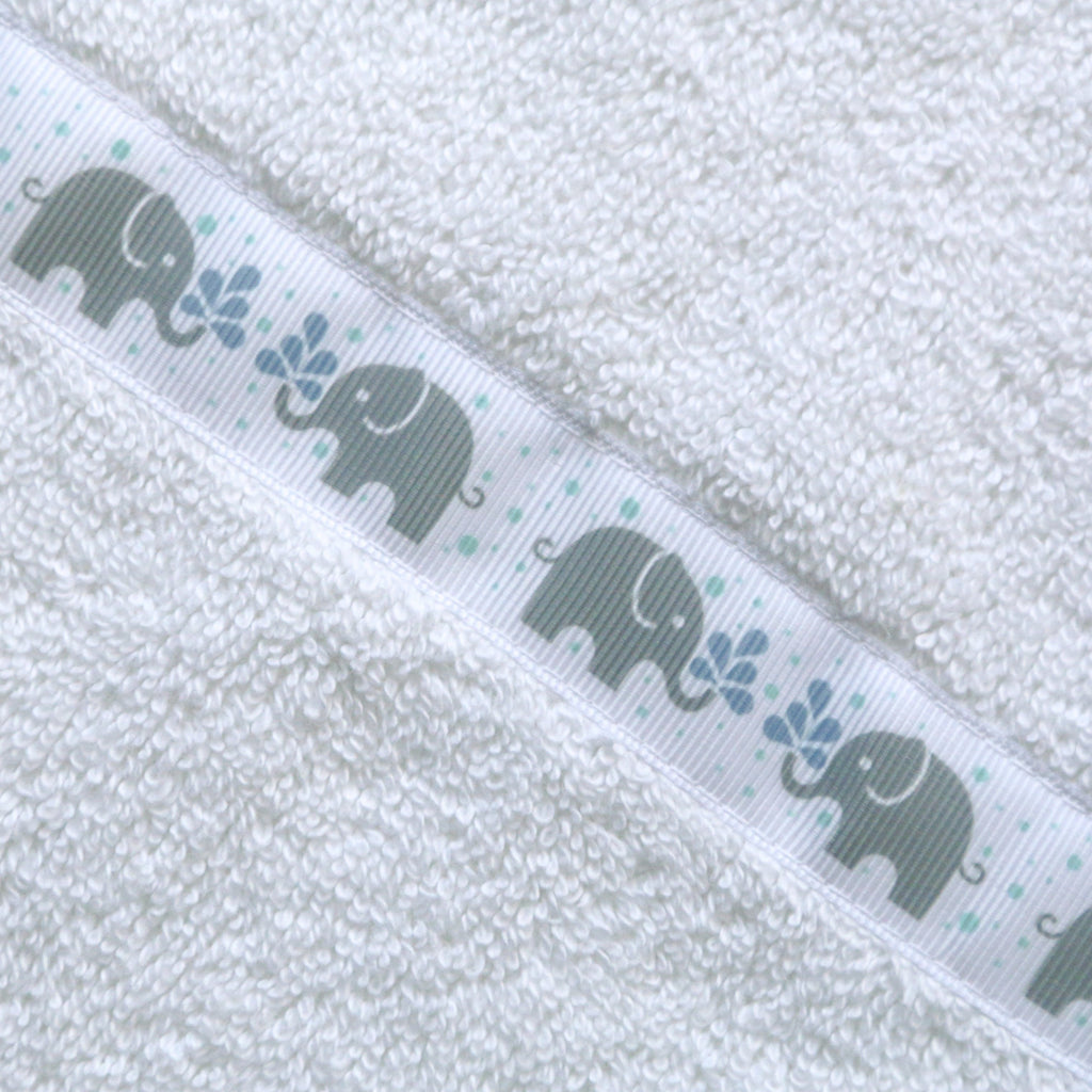 Close up of a white hooded towel with Elephants trim