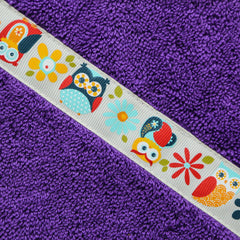 Children's purple hooded towel with Funky Owls trim