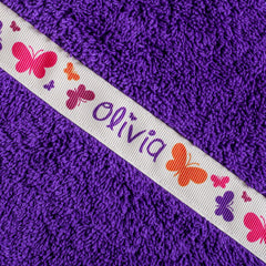 Children's purple hooded towel with personalised Butterflies trim- Olivia