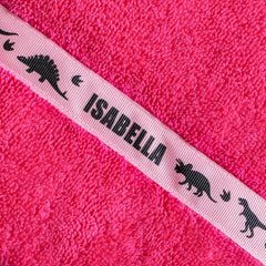 Pink hooded towel with personalised Dinosaurs trim - Isabella
