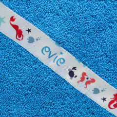 Children's turquoise hooded towel with personalised Mermaids trim - Evie
