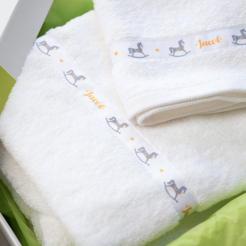 Hooded towel with personalised Rocking Horse trim and matching facelcloth