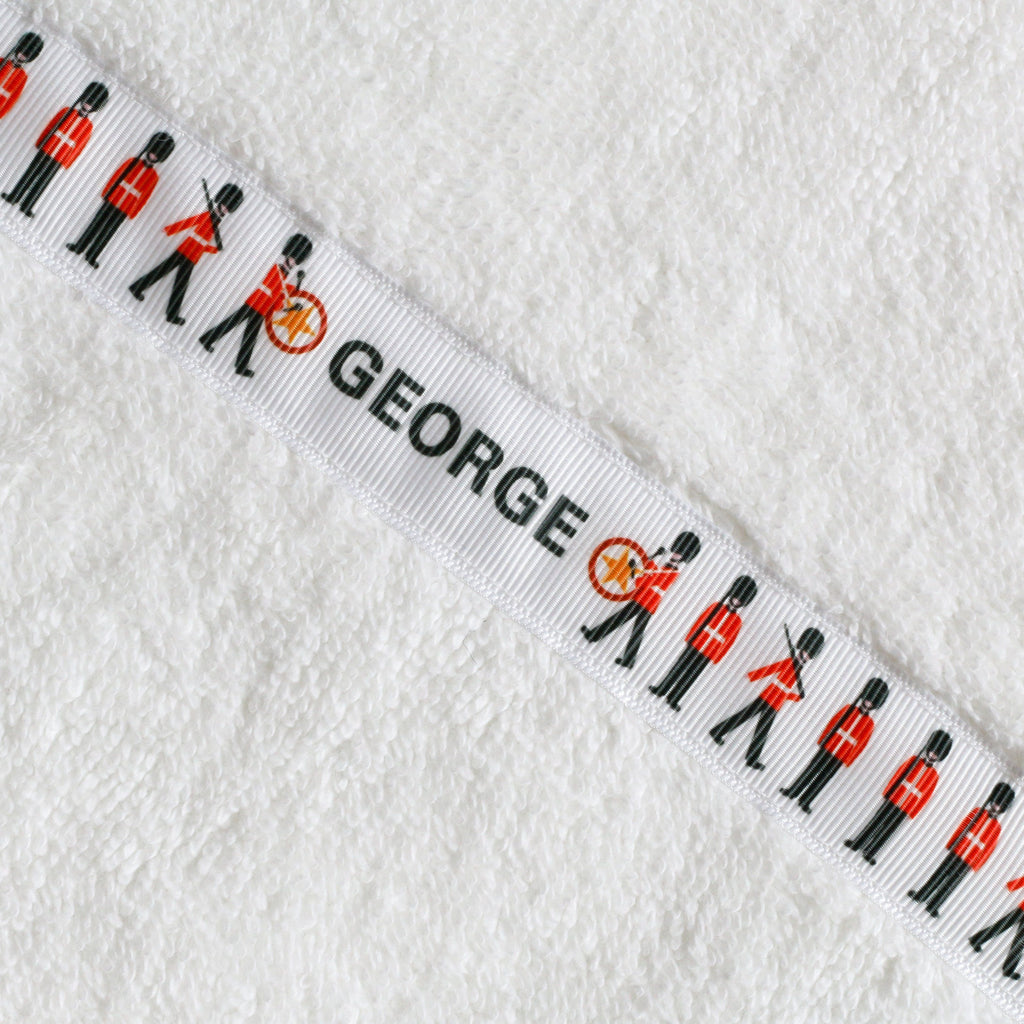 Children's white hooded towel with personalised Royal Guards trim - George