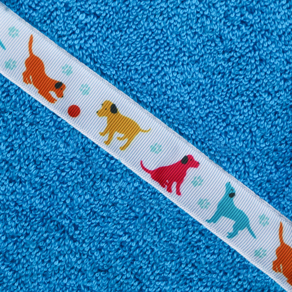 Close up of the Puppy Love trim of a turquoise hooded towel