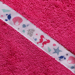 Close up of the Sea Shells trim of a pink hooded towel