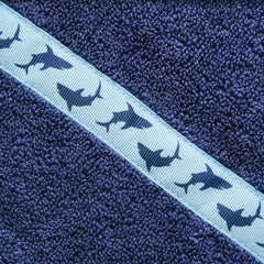 Close up of the Shark Attack trim of a navy blue hooded towel