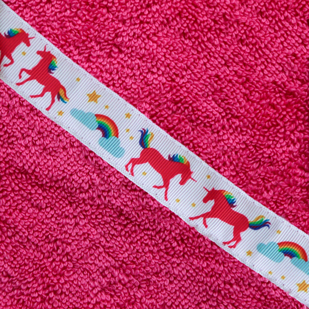 Children's pink hooded towel with Unicorns trim