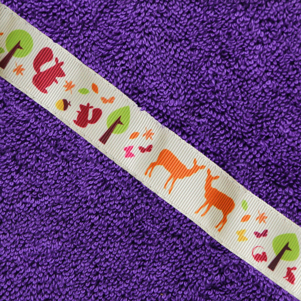 Children's purple hooded towel with Woodland Creatures trim