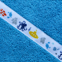 Children's turquoise hooded towel with Yellow Submarine trim