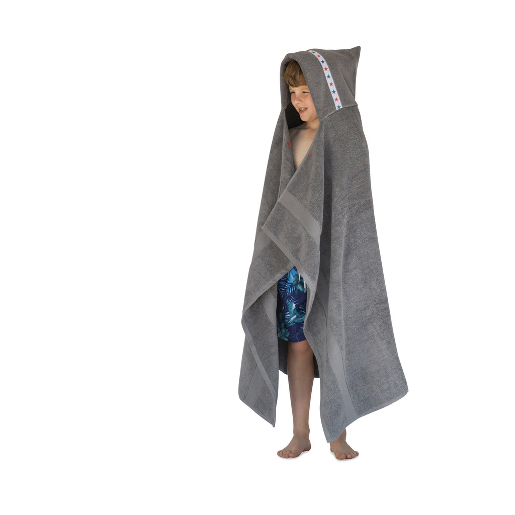 Boy wearing jumbo grey hooded towel with Red Stars trim, full length