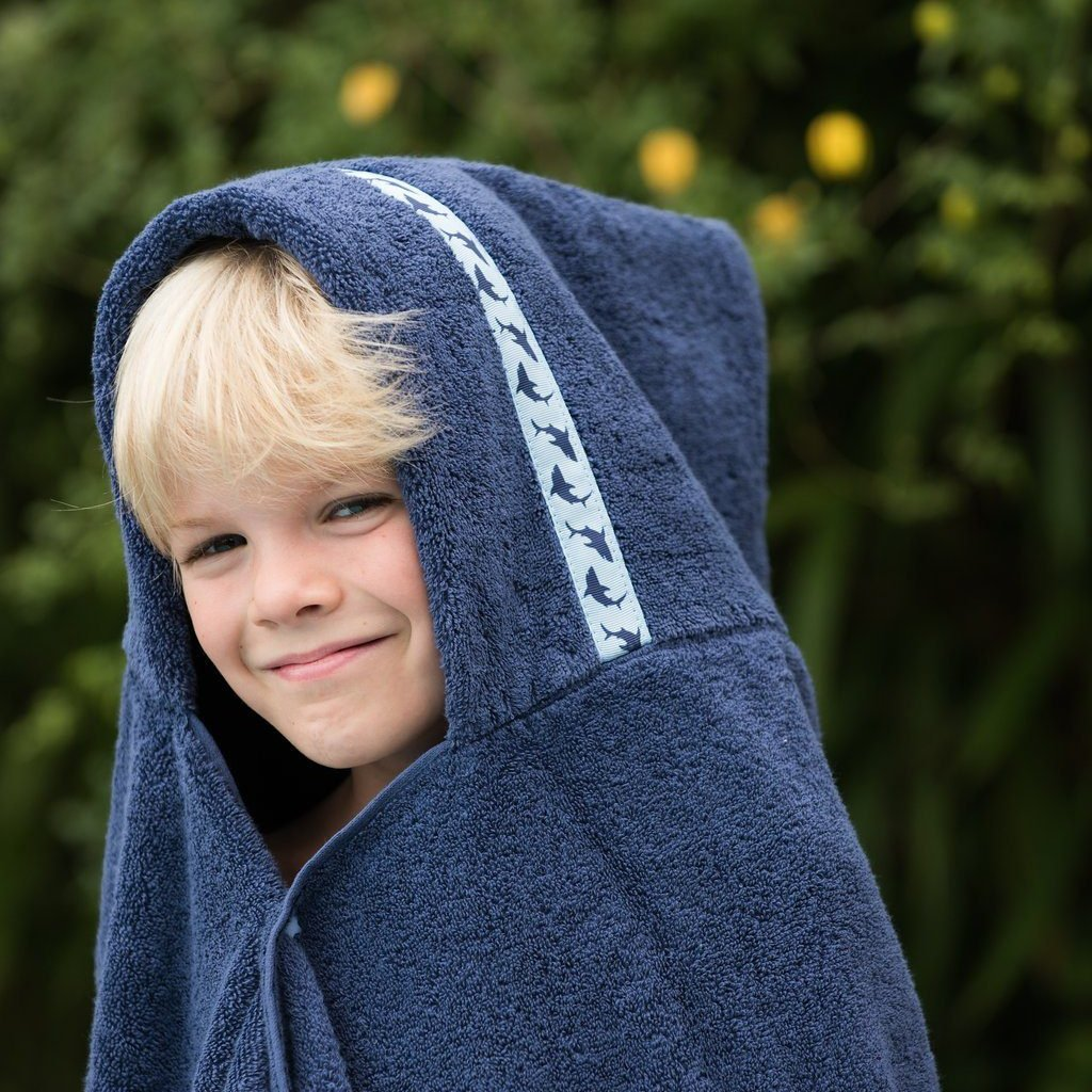 Boy wearing jumbo navy hooded towel with Shark Attack trim