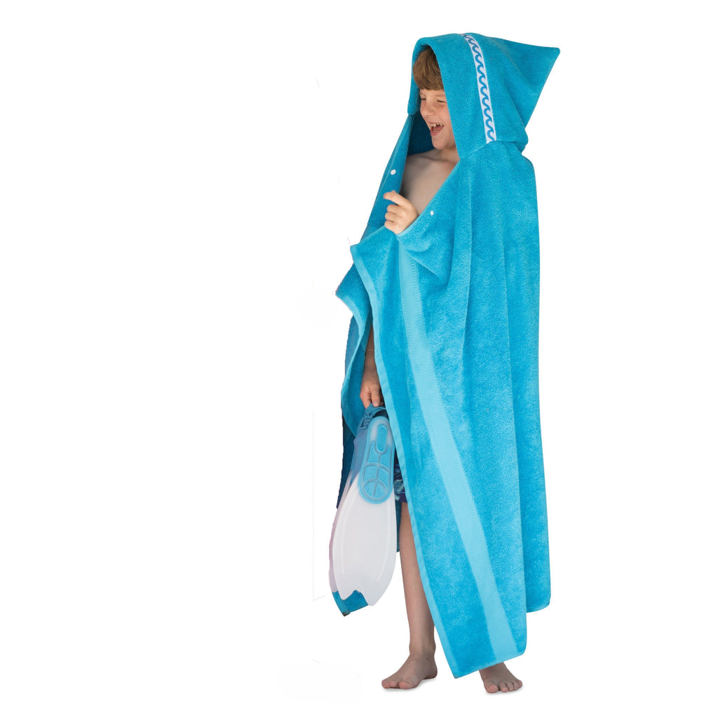 Boy wearing jumbo turquoise hooded towel with Waves trim | full length