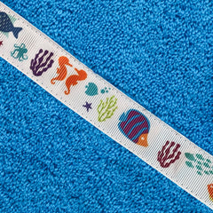 Close up of the Coral Reef trim of a turquoise hooded towel