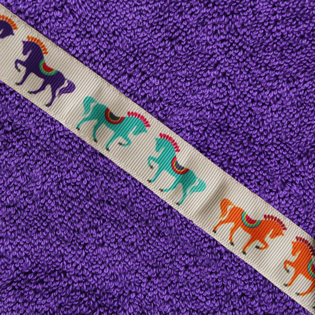 Jumbo sized purple hooded towel for older kids – dancing horses trim