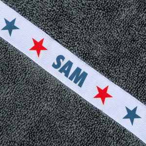 Personalised grey hooded towel - stars trim with the name 'Sam'
