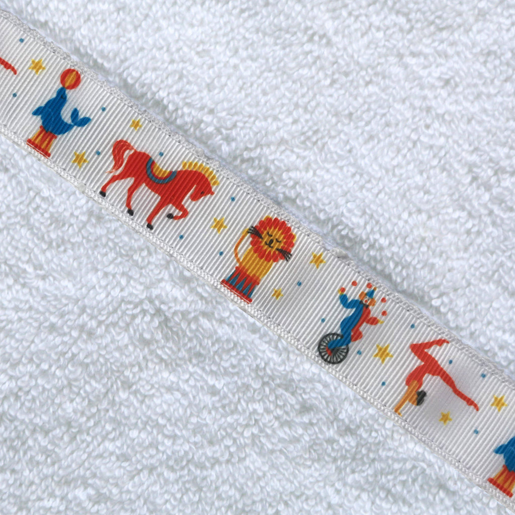 Close up of  circus trim on a white hooded towel