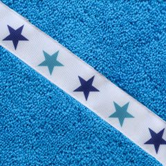 Close up of the Blue Stars trim on a turquoise hooded towel