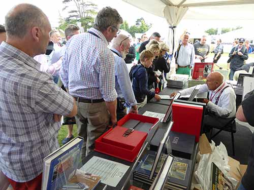 Signing books at Goodwood