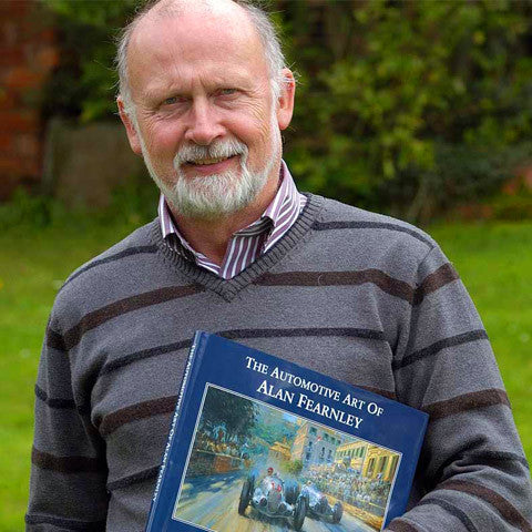 Alan Fearnley with the book of his paintings