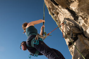 Pongoose blog - main image of climber using a Pongoose clipstick / stick clip up a route at Portland