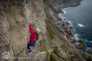 Pongoose physio blog injury avoidance for climbers - image of climber with helmet on cliffs at Portland, UK