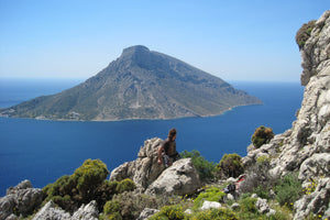 Pongoose founder Rob Rendall pictured in Kalymnos, Greece, in the sun with Telendos island and sea in background.