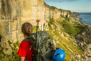 Pongoose Blog - Transitioning from indoor to outdoor climbing. Image of climber on cliffs at Portland, UK.