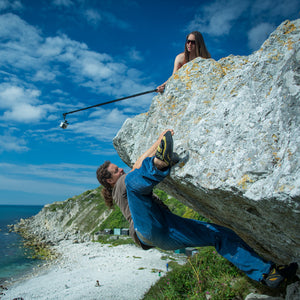 Pongoose founder Rob Rendall bouldering at Portland, Dorset, and being filmed using the Pongoose Climber 700 as a camera boom.