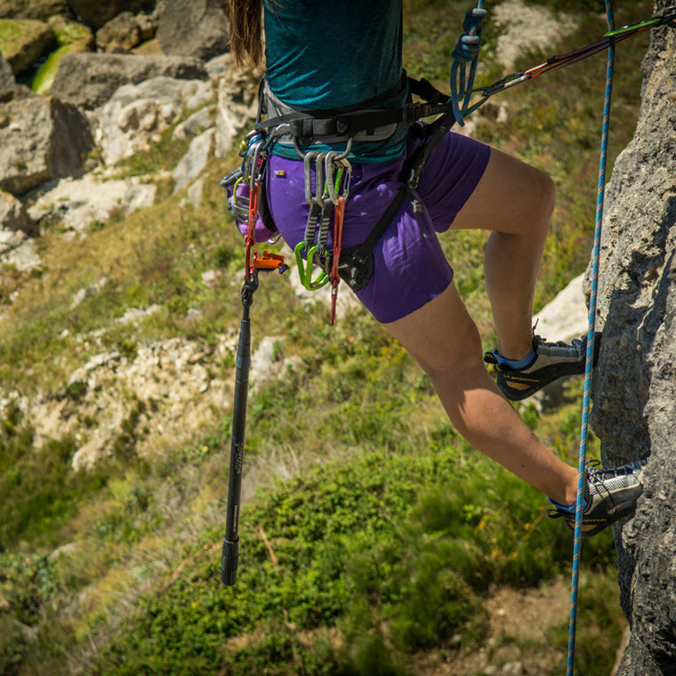 Pongoose Climber 700 clipstick pictured hanging on climbing harness whilst up a sport route in Portland, UK.