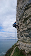 Pongoose abseiling into crag image
