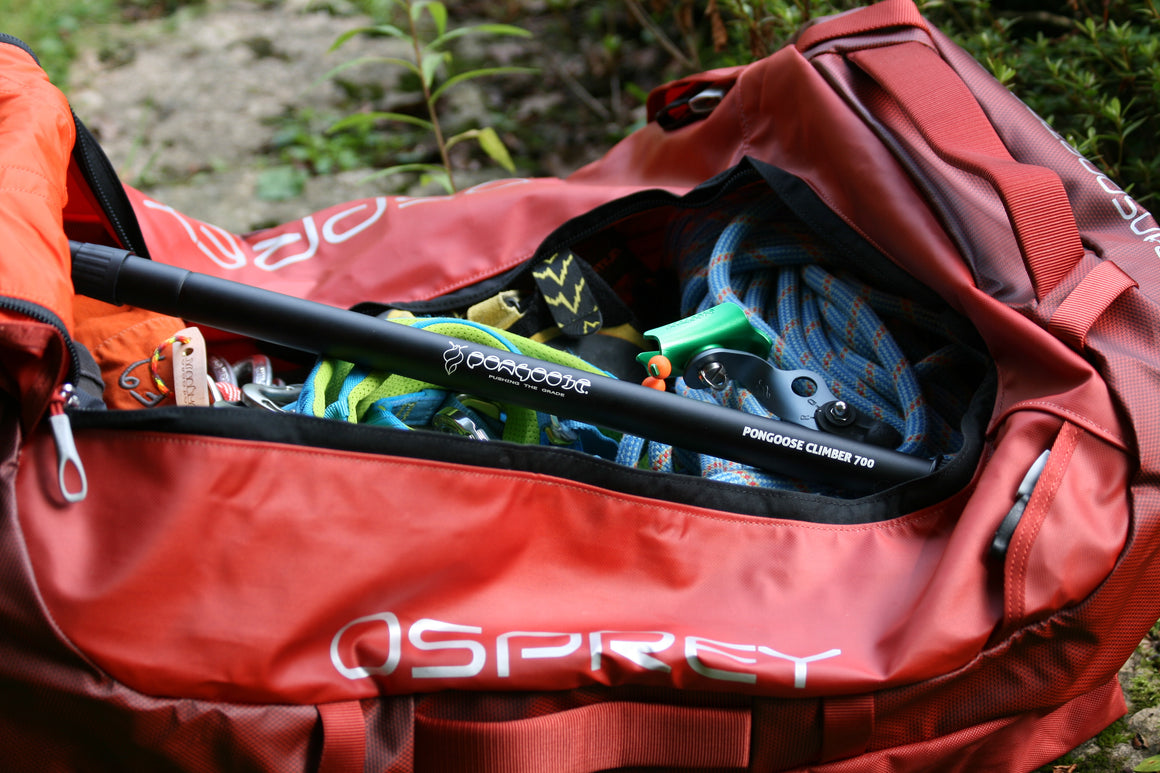 The Pongoose Climber 700 3in1 clipstick, brushing stick and camera boom featured with green head colour shown, packed inside red Osprey Transporter bag for ease of travel.