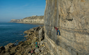 Rob Rendall of Pongoose climbing at Coastguard at Portland, Dorset, UK